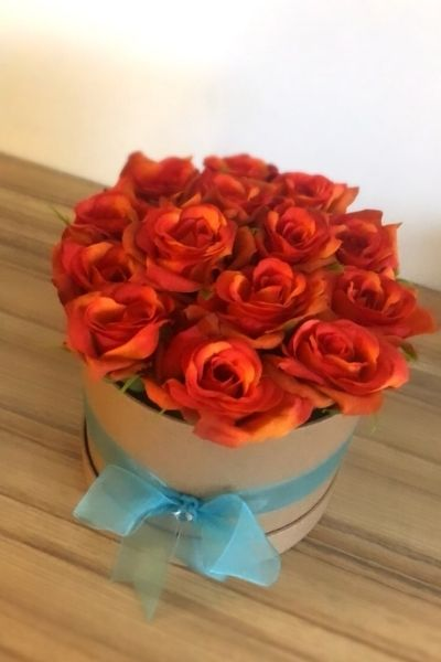 Hat box filled with red roses